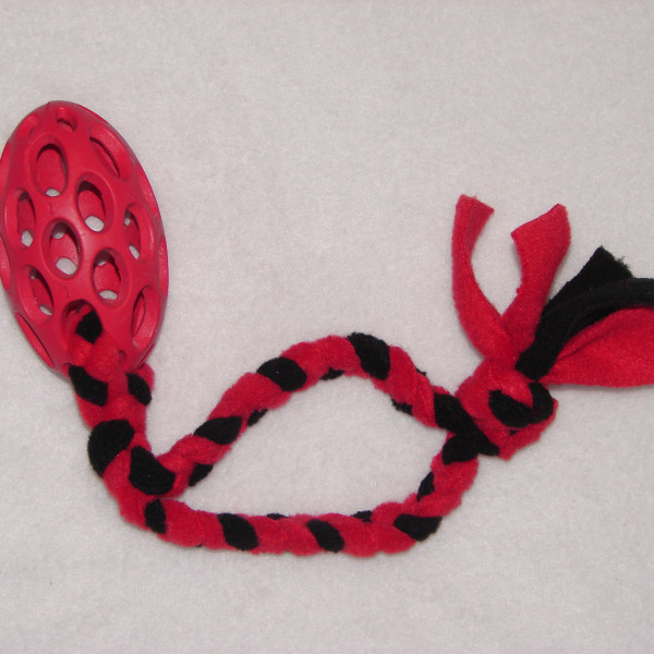 mini rubber cage ball with added plaited fleece handle